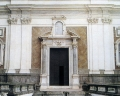 -Portal in white Carrara marble made by Bernardo Landini in 1647, surrounded by Corinthian columns and arched tympanum with aedicule inserted.